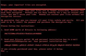 Tietokoneen ruutu, jossa on mustalla pohjalla punaista tekstiä. Teksti alkaa: Ooops, your important files are encrypted.
